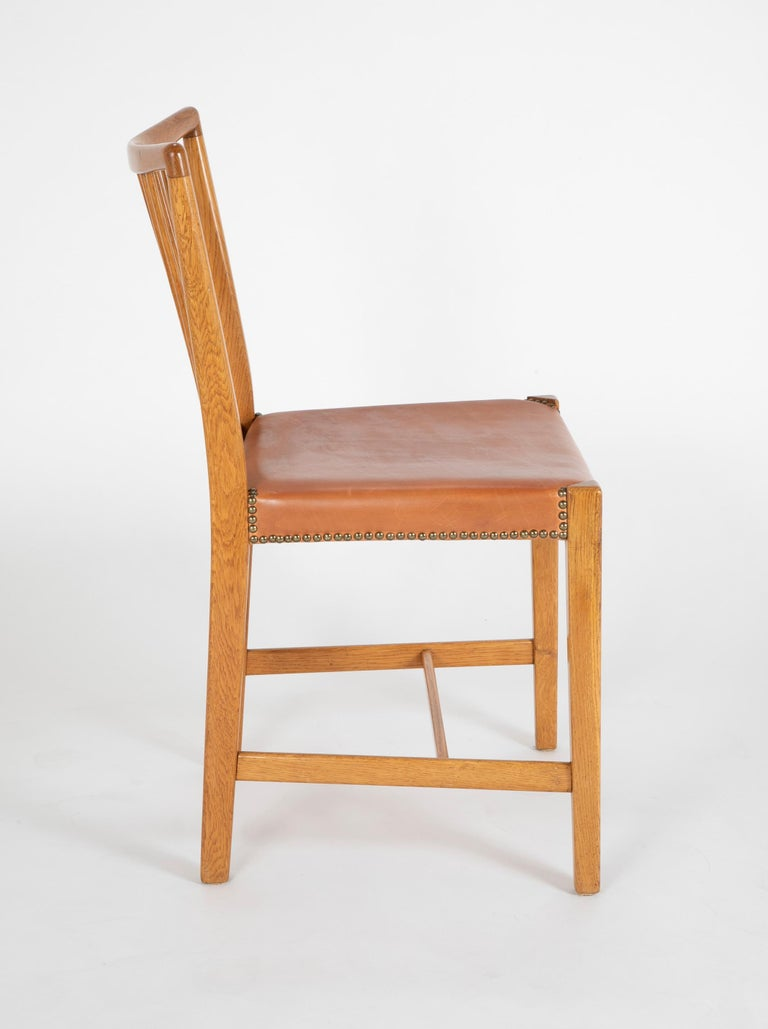 20th Century Set of 8 Dining Chairs with Leather Seats by Hans Wegner & Mikael Laursen For Sale