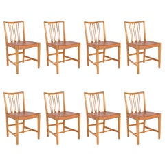 Set of 8 Dining Chairs with Leather Seats by Hans Wegner & Mikael Laursen