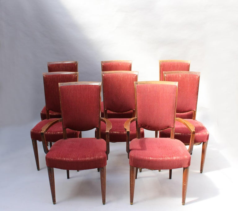 A set of 8 fine French Art Deco mahogany dining chairs (6 side and 2 arm) by Jules Leleu. Price includes refinishing (in process) with a satin finish. Documented: see pictures.  Armchair dimensions: H 35 5/8