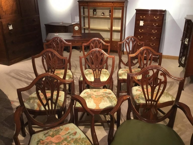 A good set of 8 (7+1) mahogany Georgian antique dining chairs. Seven chairs are matching and there is one of the same Period but a slightly different design. The seven chairs ( 6 stand chairs and 1 armchair) each having shield shaped backs with a