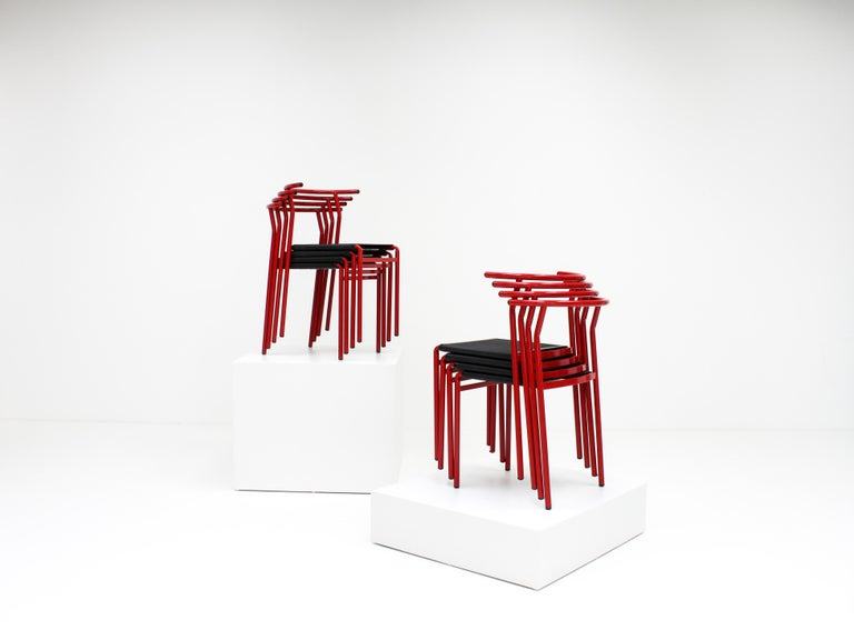 A set of 8 Philippe Starck Cafè chairs for Baleri Italia, designed in 1984 for Cafè Costes Paris.  Gloss red steel tubular frames with latex seat sprung on the underside, an important design feature in the earlier pieces.  We ship globally, please