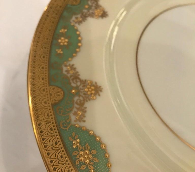 Porcelain Set of 12 Antique Raised Gilt Service Dinner Plates For Sale