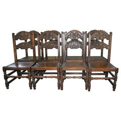 Set of Eight 20th Century Carved Oak Jacobean Style English Chairs