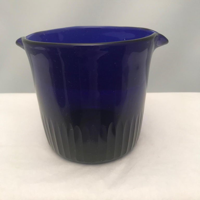 Hand blown and double-lipped, this set is also cut with vertical blazes for added elegance. The deep cobalt is most desirable and contributes a dash of color and sophisticated style to your dining room.
