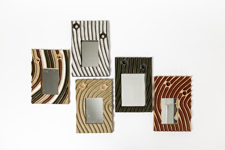 A set of five ceramic mirrors by Hervé Taquet. Perfect original conditions. Signed under the base. 2019.