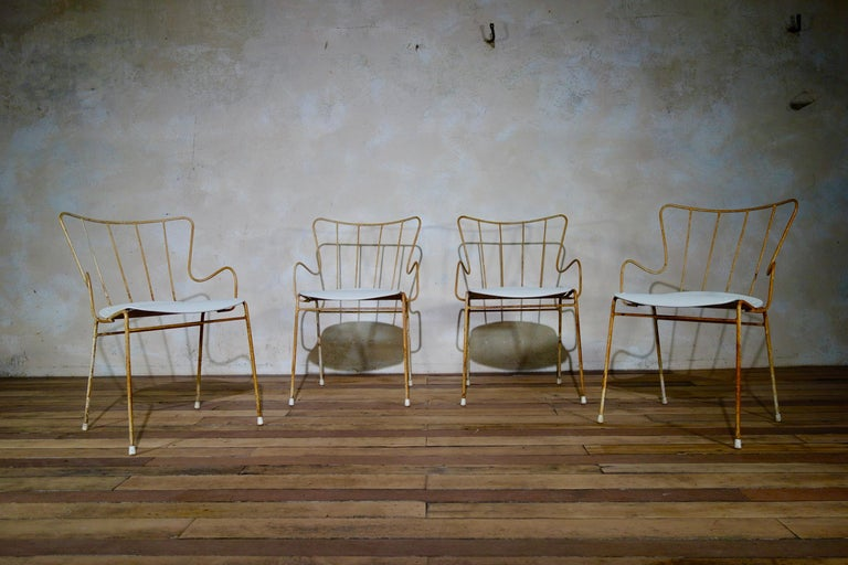 A set of four Ernest Race Antelope chairs - originally designed for the Festival of Britain outdoor terraces in 1951.   These chairs would work extremely well being used either inside or outdoors.   Constructed from die-cast aluminum and steel rods