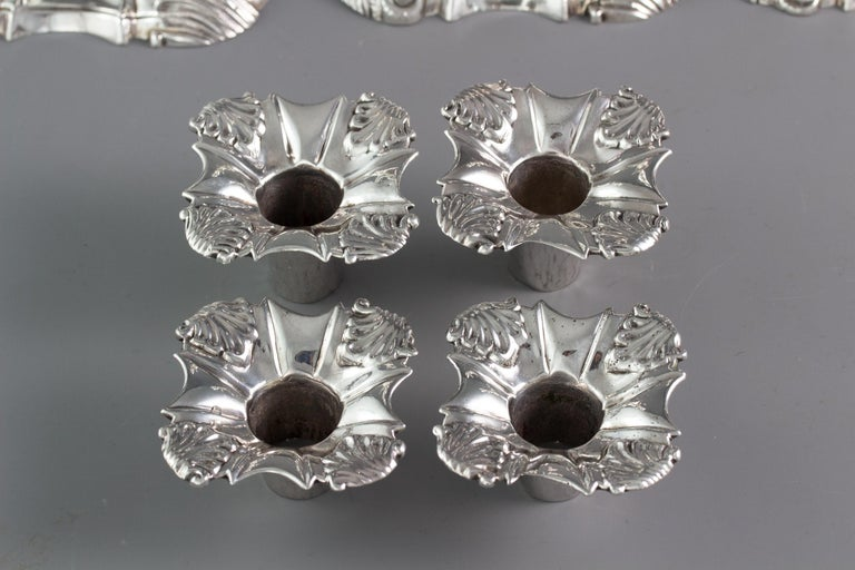 British Set of Four Cast Silver Candlesticks, London, 1764-1765 For Sale