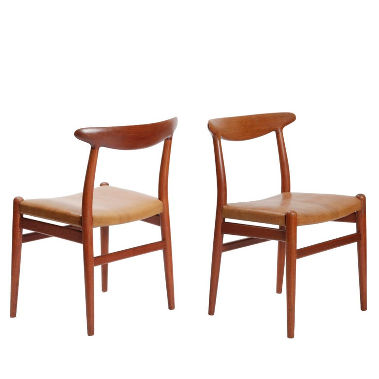 A set of four dining chairs, model W2, in teak with seat recovered in Niger goatskin. Designed by Hans Wegner in 1950 and beautifully crafted by cabinetmaker C.M. Madsen, Denmark.