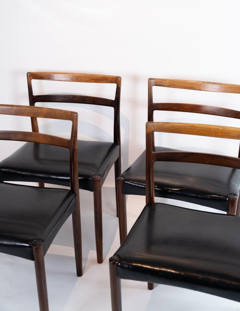 Scandinavian Modern Set of Four Dining Room Chairs in Rosewood and Black Leather of Danish Design For Sale