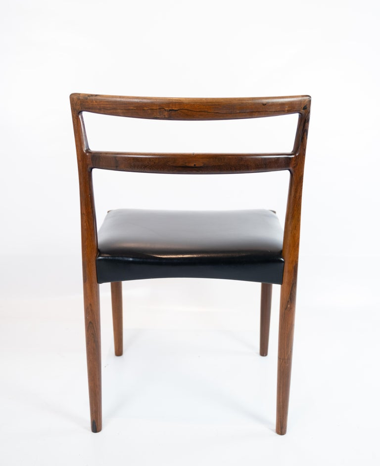 Set of Four Dining Room Chairs in Rosewood and Black Leather of Danish Design For Sale 2