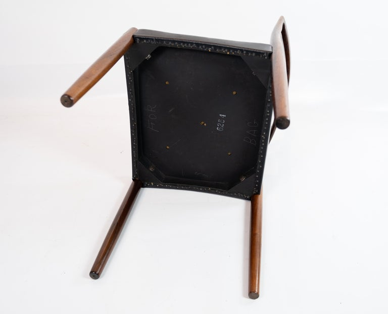 Set of Four Dining Room Chairs in Rosewood and Black Leather of Danish Design For Sale 3