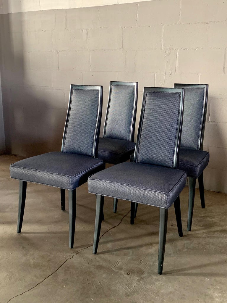 A set of elegant, high back dining chairs by Harvey Probber. Finished in black lacquer.