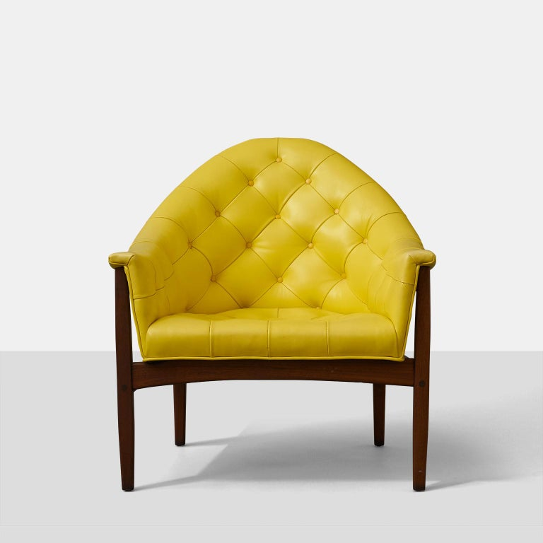 A set of four tufted lounge chairs by Milo Baughman for Thayer Coggin. Walnut frames and buttercup yellow upholstery. A rare early entry in Baughman and Coggin's three decade colaboration. Price is per set of 2.
