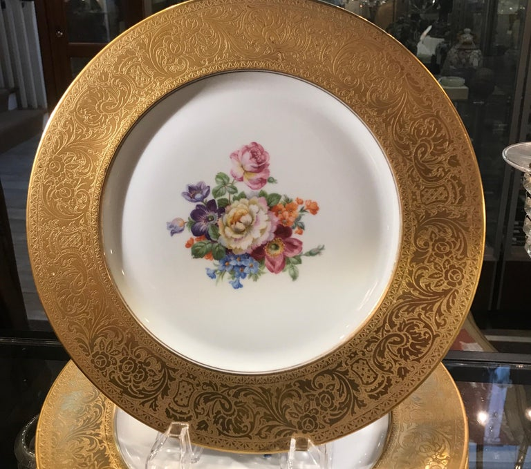 12 Heinrich and Co elegant service plates with thick gold borders and Dresden style floral centers, Early to mid 20th century, Germany.