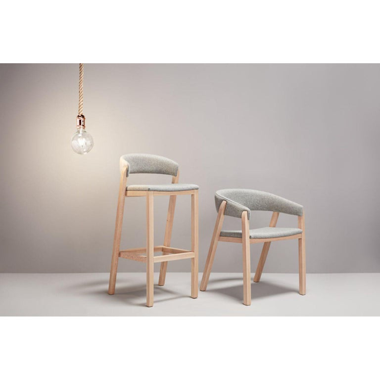 A set of gray Oslo stool & chair by Pepe Albargues Dimensions: Stool W48, D50, H101, Seat78, Chair W59, D50, H75, Seat 46 Materials: Beech wood structure Foam CMHR (high resilience and flame retardant) for all our cushion filling systems  Also