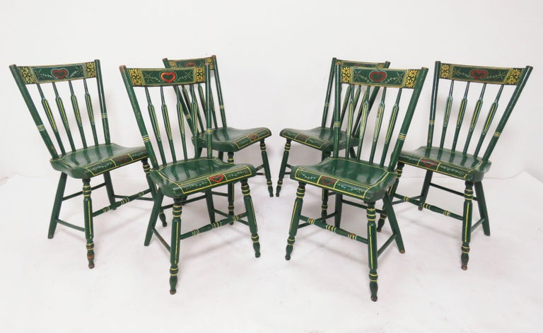 A set of six 19th century Pennsylvania Windsor chairs, embellished in the German Folk Art tradition of Lancaster County. A rare set found intact in their original Bauernmalerei (literally, farmer's painting) decoration. Though the chairs themselves