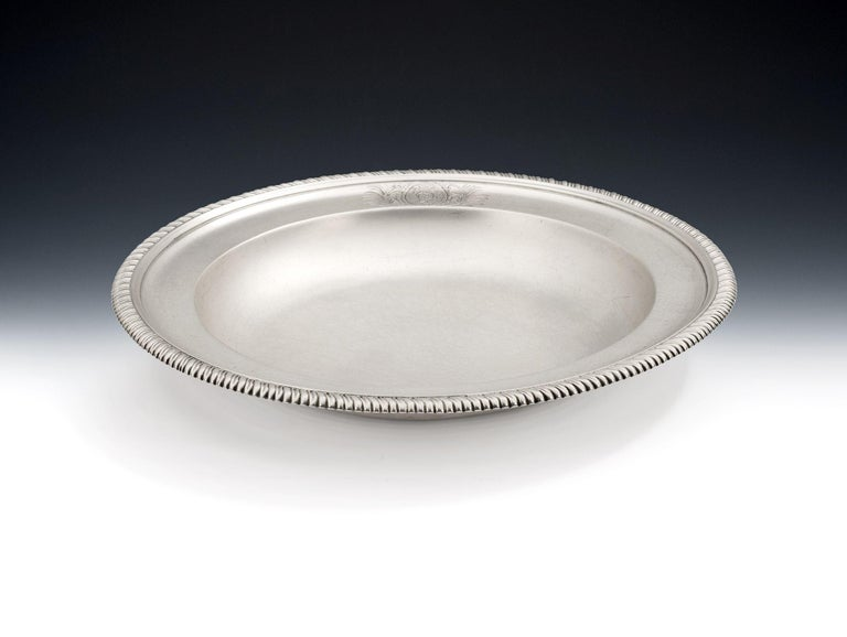 The Minstead Manor Soup Plates. A very fine set of six George III Soup Plates made in London in 1811 by William & John Frisbee. The Soup Plates are circular in form with a deep bowl and raised, stepped, rim decorated with gadrooning. The border is