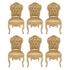 A set of six Italian 19th century Louis XV st. painted giltwood dining chair