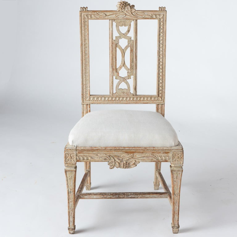 These beautifully crafted chairs were designed by Carl Wilhelm Carlsberg, a noted chair maker in Lindome Sweden, in the 18th and early 19th century. This model of chair was created for the dining room at the Gunnebo Manor House outside of