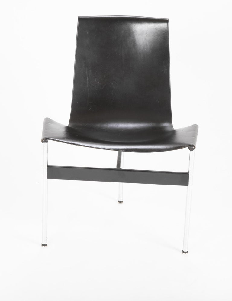 A set of 6 black leather and polished chrome T dining chairs designed by Douglas Kelly, Ross Littell and William Katavolos. Original leather in good condition.