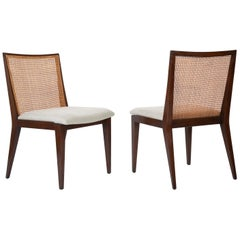 A Set of Six Walnut and Caned Dining Chair designed by Edward Wormley
