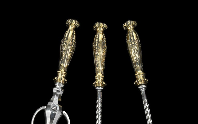 With elaborate brass knob handles and twisted steel stems.