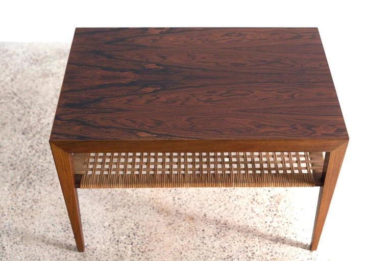 A Severin Hansen side or coffee table in Brazilian rosewood with cane shelf.  Designed by Severin Hansen 1960s and made at Haslev møbelsnedkeri in Denmark.