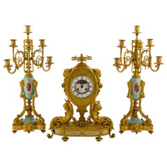 Sèvres-Style Gilt Bronze and Jeweled Porcelain Clock Set