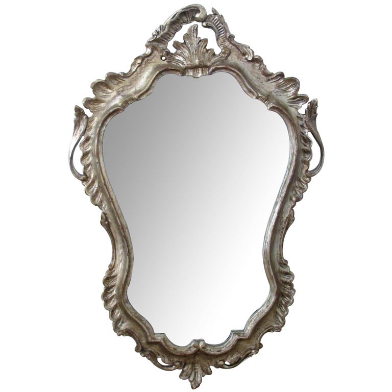Shapely Venetian Rococo Style Silver-Leafed Giltwood Cartouche-Shaped Mirror