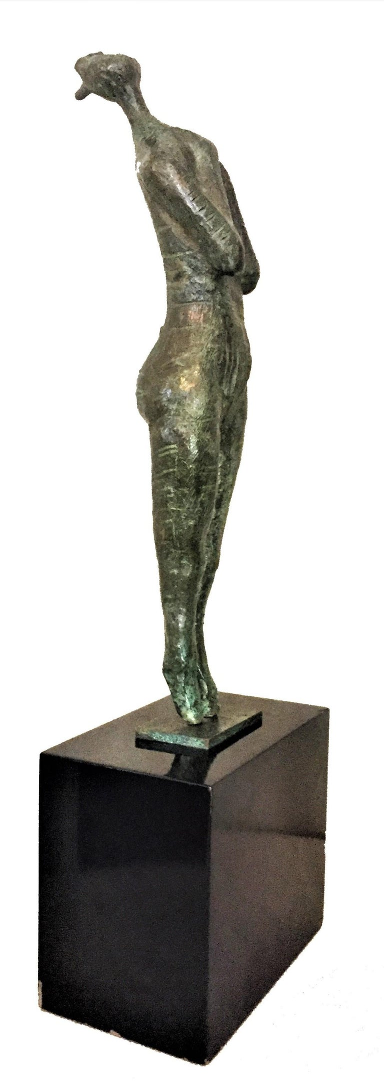 """Signed """"Igor '67"""", this beautifully cast patinated bronze sculpture depicts a woman on tiptoe, arms folded across h?? chest, head up and screaming with all her might, mouth wide open. Original lacquered wood base.  Dimensions: Height (max):"""