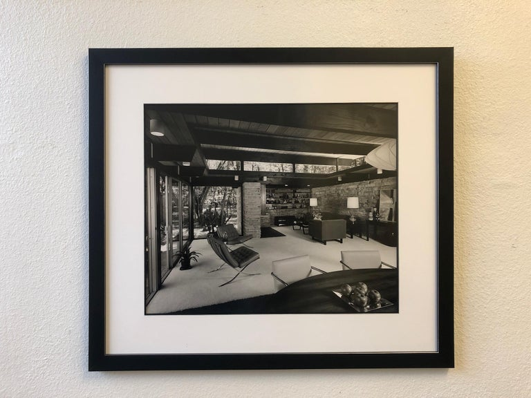 """A large signed architectural photograph by Julius Shulman. This is a silver gelatin and its hand signed in the back. The photograph is frame with a black lacquered with silver outline frame and none glare UV protection acrylic. The photo is 24"""" wide"""