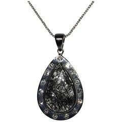 Silver Pendant with Diamond and Quartz with Graphite Needles, Graphitite
