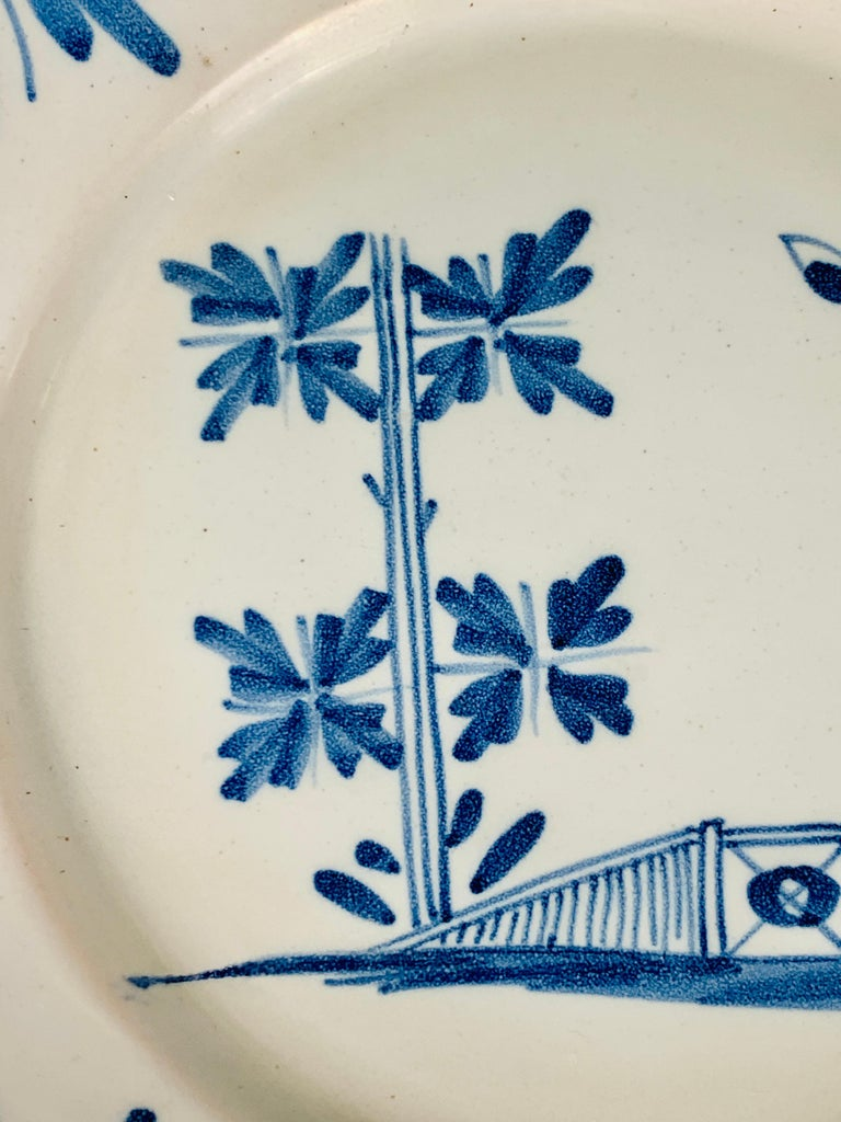 18th Century Small Blue and White Hand-Painted Delft Plate Made, circa 1740 For Sale