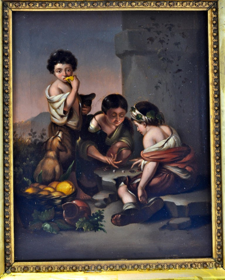 """A well executed 18 century small oil painting on tin in a period gilt frame of one of the old Baroque Spanish Master Bartolomeo Estaban Murillo's ( 1670- 1675) paintings titled """"Boys Playing Dice"""" hanging in the Alte Pinakothek in Munich"""