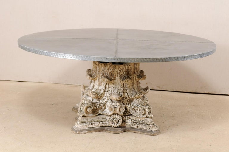 A custom zinc top and early 20th century capital base dining table. This fabulous custom table has been fashioned from the base of an antique American plaster and terracotta column, heavily adorn in acanthus leaf motif, topped with the addition of a