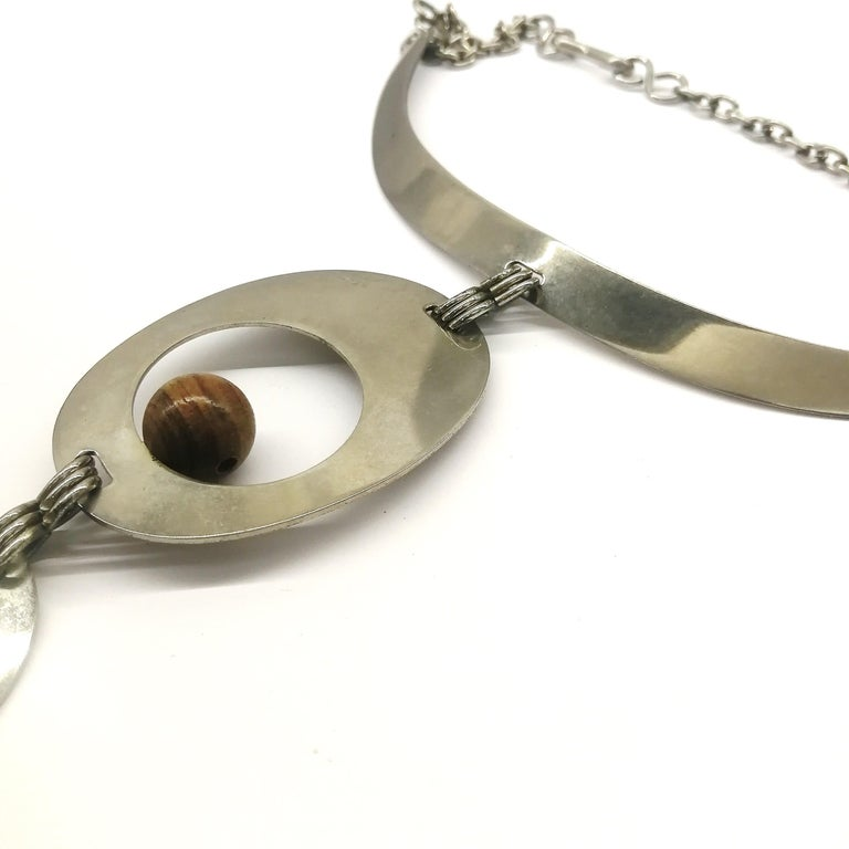 A stunning chrome and walnut 'amoebic' pendant necklace, Pierre Cardin, 1970 For Sale 6