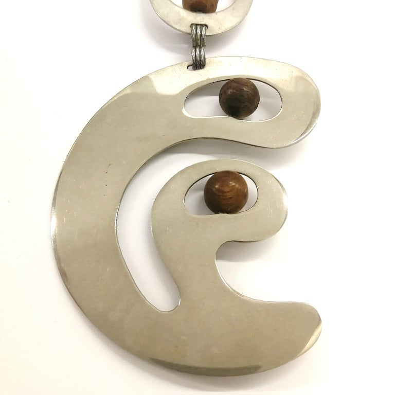 Women's A stunning chrome and walnut 'amoebic' pendant necklace, Pierre Cardin, 1970 For Sale