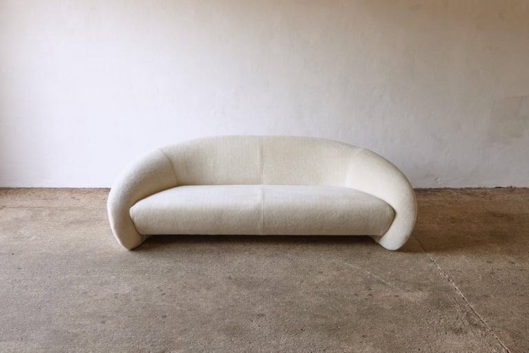 A superb rare Italian curved sofa or organic form, late 1970s-early 1980s, Italy. Newly reupholstered in thick cream alpaca velvet.     Please note: Prices do not include VAT. VAT may be applied depending on the ship-to location.