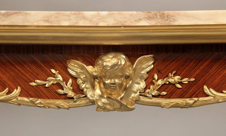 A superb late 19th century gilt bronze mounted Regence style center table by François Linke