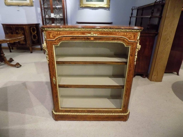 A superb pair of Victorian period burr walnut, kingwood and marquetry inlaid pier cabinets by Wilkinson & Sons, London. Each top is veneered in the finest burr walnut with kingwood and tulipwood banding above a fine marquetry inlaid frieze and