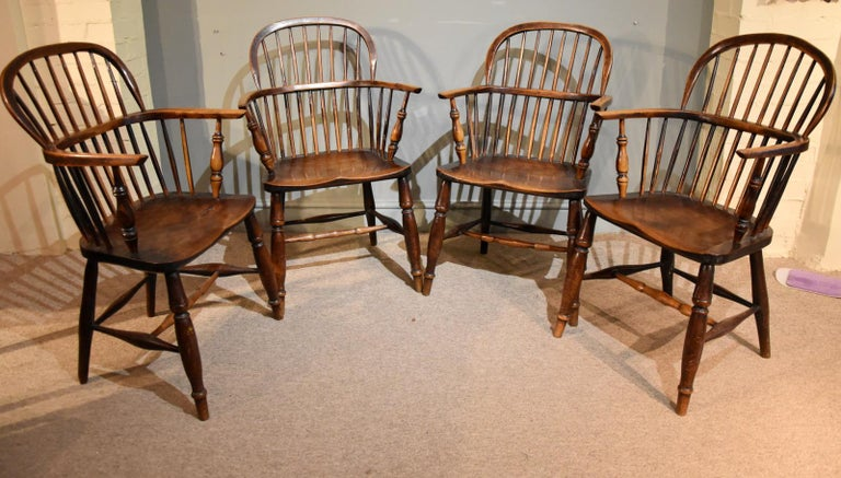 A Superb set of four George III ash and elm Windsor chairs of good colour  Dimensions  Height 40.5