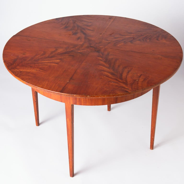 This spectacular table retains the original grain painting in a lovely pattern of feathery shapes emanating from the center. The condition of the paint is excellent with a few minor touch ups, but retains the original surface, showing the creativity