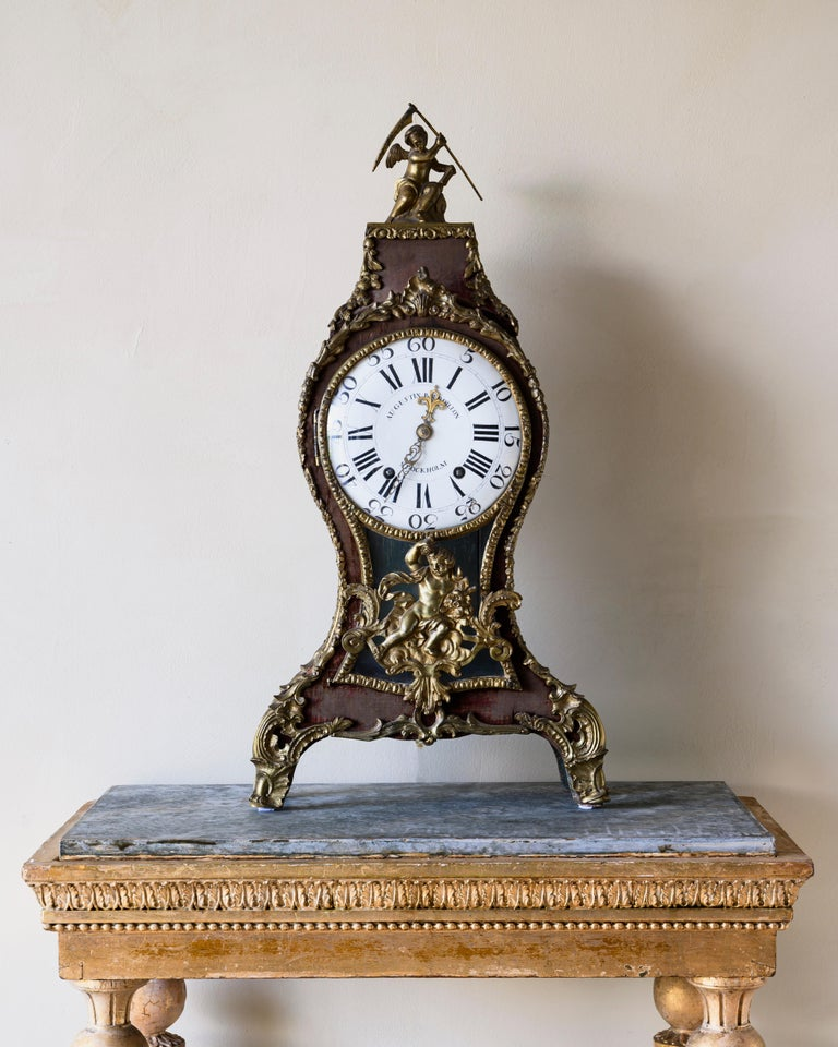 A fine Swedish 18th century rococo ringtone table clock with gilt bronze signed by Augustin Bourdillon. Covered in the original velvet with great patination. The interior of the case is painted with a chessboard pattern, Ca 1761-1770, Stockholm.