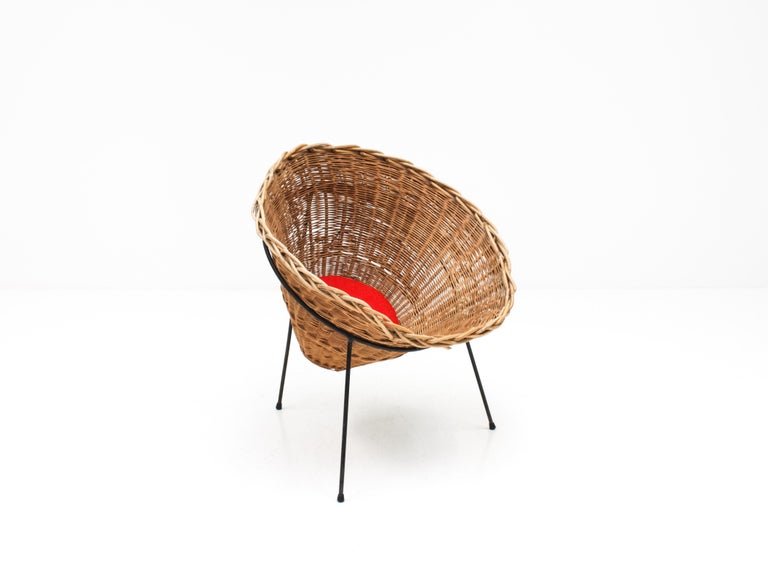 A Terence Conran C8 cone chair, Conran Furniture, England, 1954.  A seldom found Terence Conran C8 cone chair. Dating from 1954 this is an early example which was produced by Conran Furniture.  The willow basket weave sits on a tripod steel rod