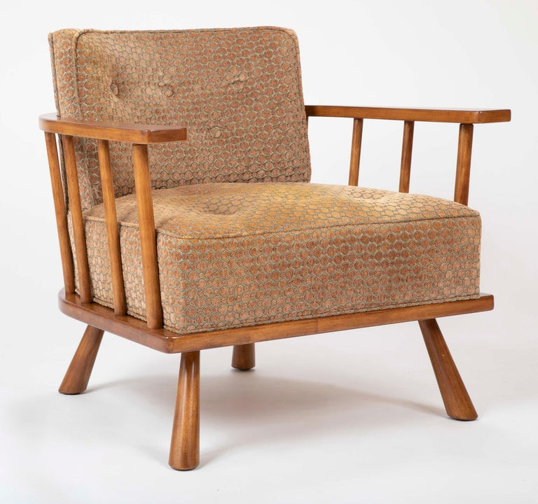 A barrel back lounge chair designed by T.H. Robsjohn Gibbings. Produced by Widdicomb with tag under seat. Model number 1682, circa 1955.  Measure: Seat height 16