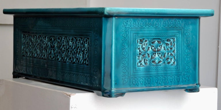 A Rectangular Théodore Deck blue-Persian faience cachepot in the Islamic style, modelled in low relief and incised with interlacing and rosette pattern.