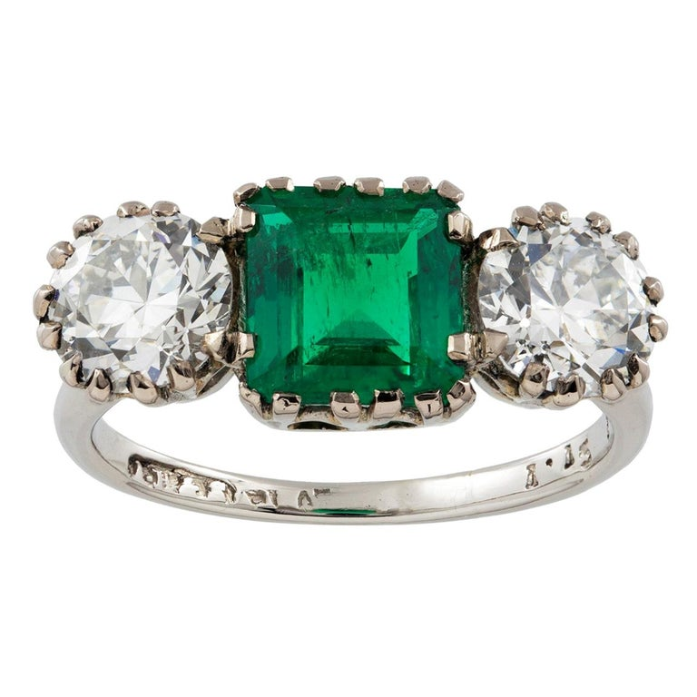 Three-Stone Diamond and Emerald Ring For Sale