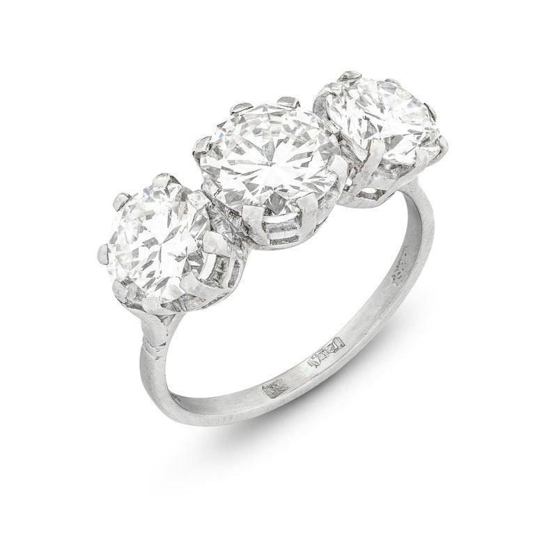 Modern Three-Stone Diamond Ring For Sale