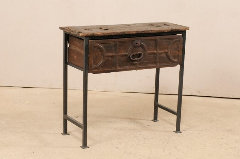 A fabulous custom created chest with 18th century Spanish drawer and iron legs. This unique and custom designed side chest features an 18th century (or earlier) carved wood drawer from Spain, which has been topped with reclaimed wood above, and set