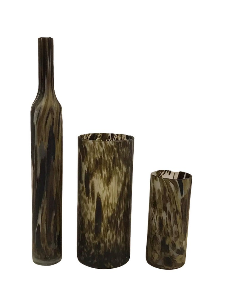 Set of 3 mouth blown and hand made opaline glass vessels made in Empoli, Tuscany outside Florence. A lovely striated design with a color palette of muted browns on a matte surface. Classic and elegant, very tall bottle and two graduated size